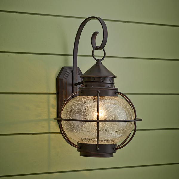 onion-style porch lantern of aluminum with oil rubbed bronze finish and seeded glass