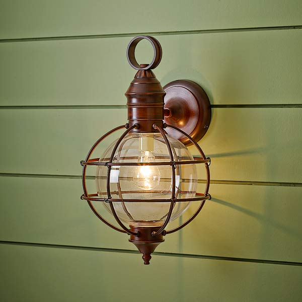 onion-style porch lantern of steel with distressed dark red finish and clear glass