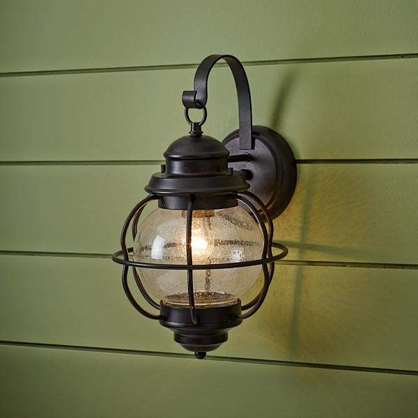 onion-style porch lantern of steel with black finish and seeded glass globe