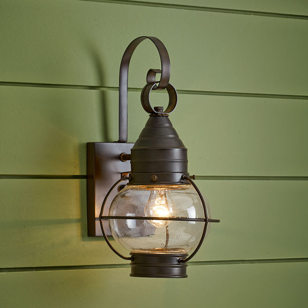 onion-style porch lantern of brass with bronze finish and seeded glass globe