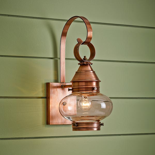 onion-style porch lantern of solid cooper with antiqued finish and clear glass globe