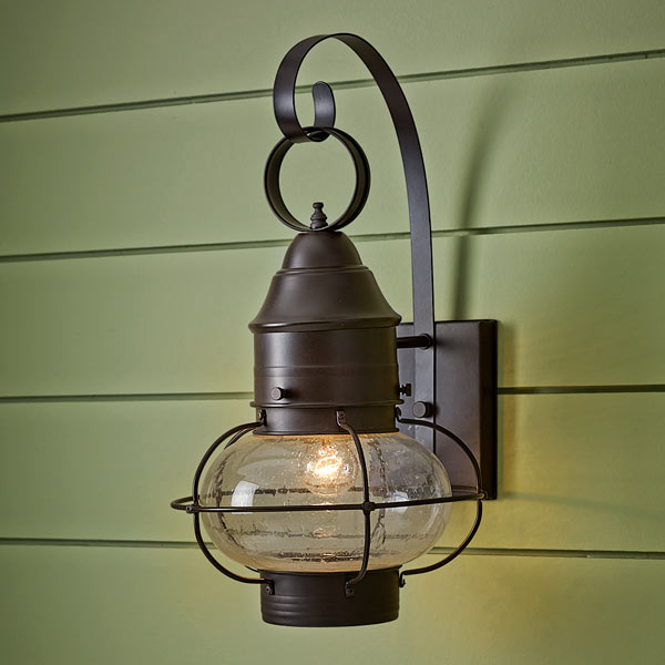 onion-style porch lantern of steel with rust colored finish, seeded glass globe