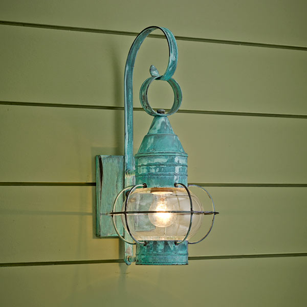 onion-style porch lantern of copper with verdigris finish and clear glass globe