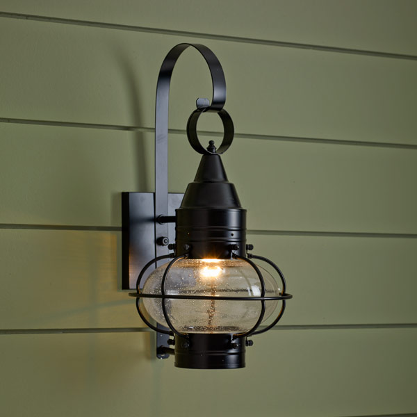 onion-style porch lantern of brass with black finish and seeded glass globe