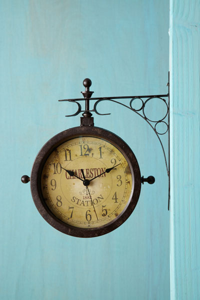 retro style railway thermometer/clock with antique looking railway label, clock side facing