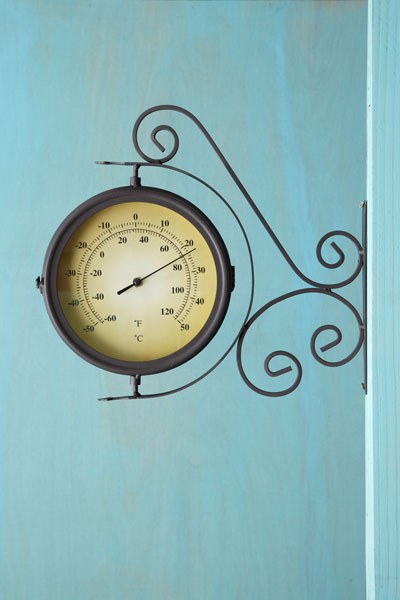 railway thermometer/clock with upper and lower scrolled bracket, thermometer side facing