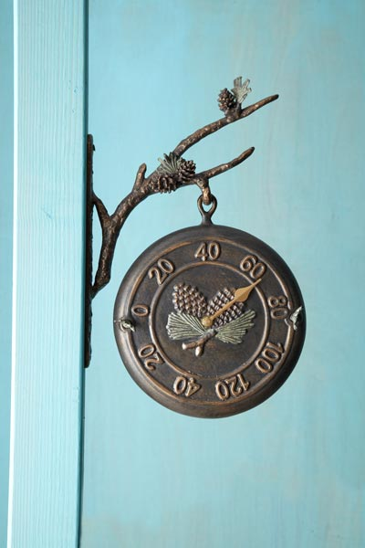railway thermometer/clock with patinated leaf and pinecone themed bracket, thermometer side facing