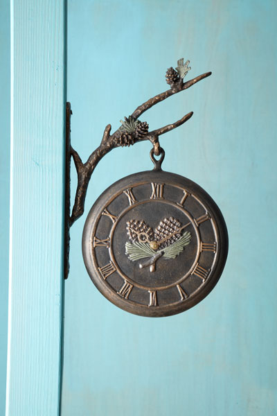railway thermometer/clock with patinated leaf and pinecone themed bracket, clock side facing