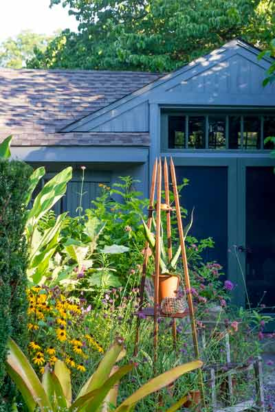 yard with outdoor rooms, obelisk with vine