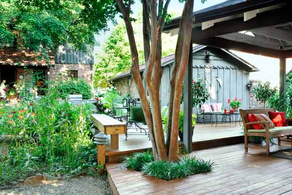 two-level deck built around an existing crape myrtle after backyard remodel