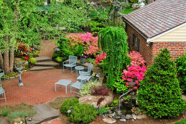 after yard remodel with bricked patio areas, irrigation system and perennials