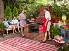 family gathered around a Built-in Barbecue Pit