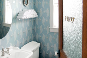 patterned wall paper in a powder room illustrating the half baths full of style gallery