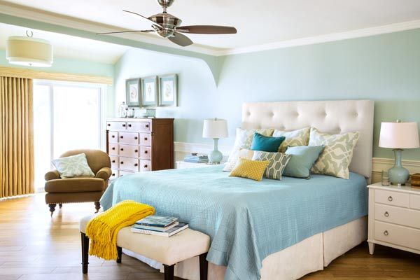 after remodel light blue bedroom remodel with fireplace and sitting area