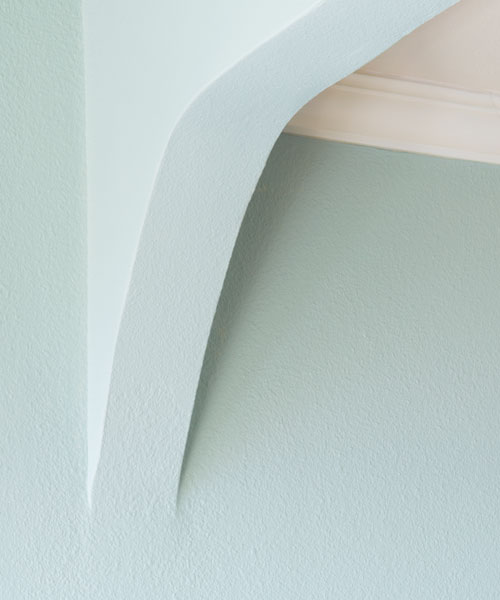 drywall arch to hide change in ceiling height, after remodel light blue bedroom remodel with fireplace and sitting area