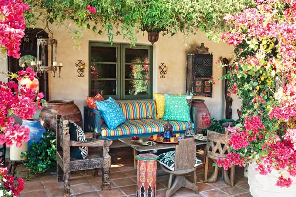 colorful terrace surrounded by hanging roses for Get This Look: Well-Traveled Terrace