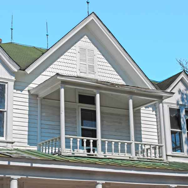 exterior details with balcony under center gable, save this old house Grimesland north carolina victorian farmhouse