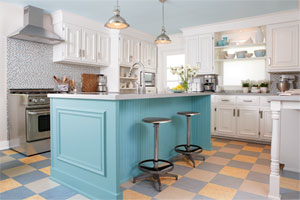 classic two-tone checkerboard pattern of linoleum floor tiles in this kitchen with a blue island and open shelves above the counter