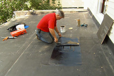 Tom Silva patches a leaky rubber roof
