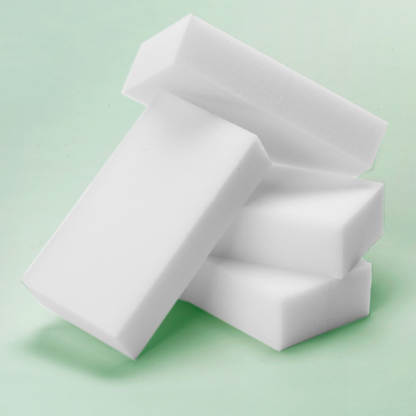 Mr. Clean Magic Eraser foam sponges on a green background, cleaning alternatives for exterior cleaning problems