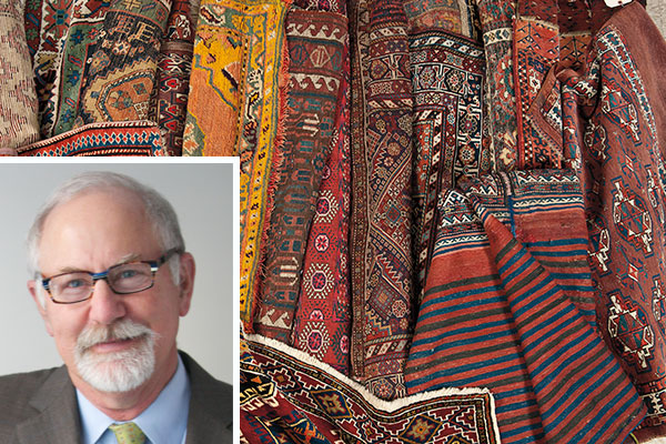 room filled with rolled up rugs with inset of Stephen Fletcher