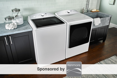 white, side-by-side washer and dryer set into a counter in a clean, modern room with a utility sink to the right side