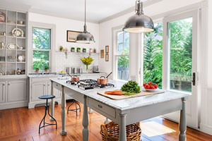 bright and airy kitchen remodel, focus on kitchen island and French doors to deck
