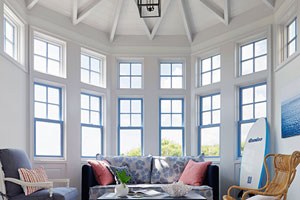 a large half-octagonal bay window with beach house hints