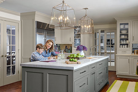 kitchen remodel with mother and son sitting at the kitchen island
