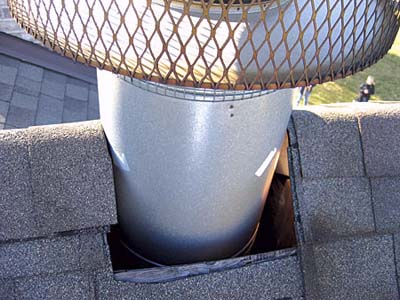 home inspection photo of hole in roof around chimney