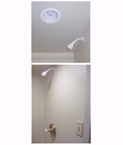 home inspection photo of unprotected light bulb and switch in shower