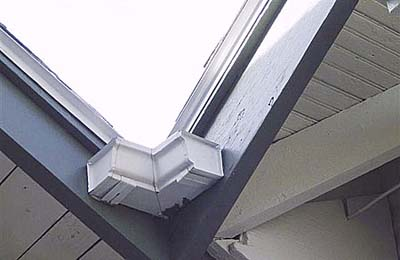 home inspection photo of rain gutter capped at both ends
