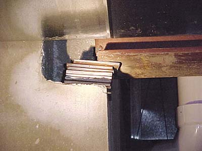 home inspection photo of improperly secured I-beam