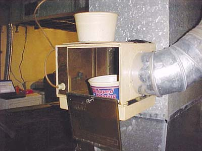 home inspection photo of Cool Whip container in humidifier