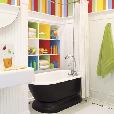 finished kid's bathroom remodel with brightly colored walls and cubbies