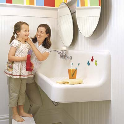 kid's bathroom remodel with mother and daughter in front of sink and mirror