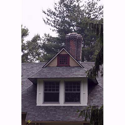 a dormer made to look smaller than it really is through a Vanishing Point