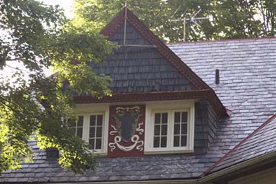 a dormer with Decorative Flourishes