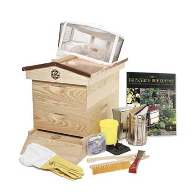 a beekeeper's kit with wooden hive