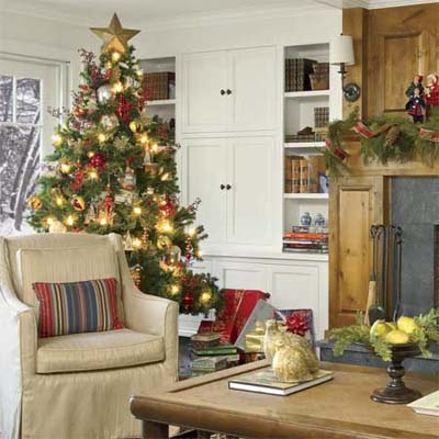Christmas tree in front of custom built=in cabinets flanking fireplace