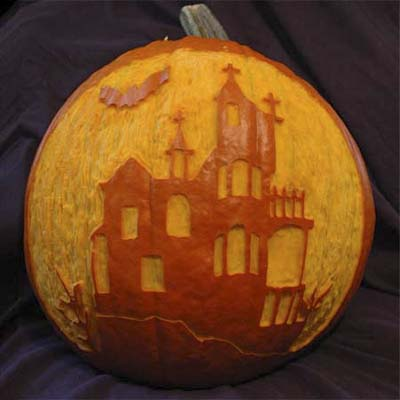 haunted house carved pumpkin