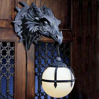wall sconce shaped like a dragon