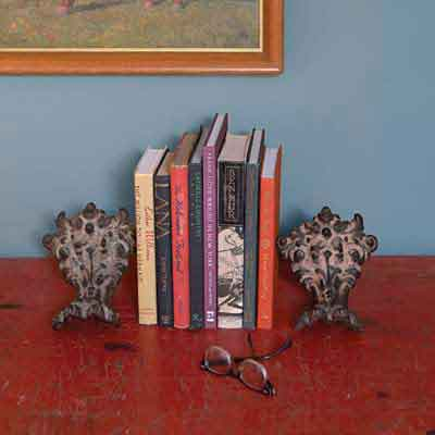 claw-foot tub feet used as bookshelf bookends