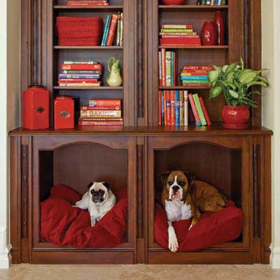niches below a bookshelf converted into recessed dog beds