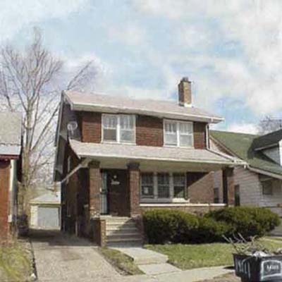 three bedrooms and a garage come with this 1923 brick home in this urban neighborhood of Detroit