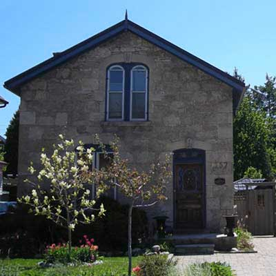 an old stone Italianate workers' cottage in St. Patrick's Ward, Guelph, Ontario, Canada