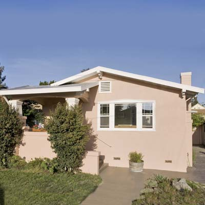 a stucco bungalow in the Temescal neighborhood, Oakland, California