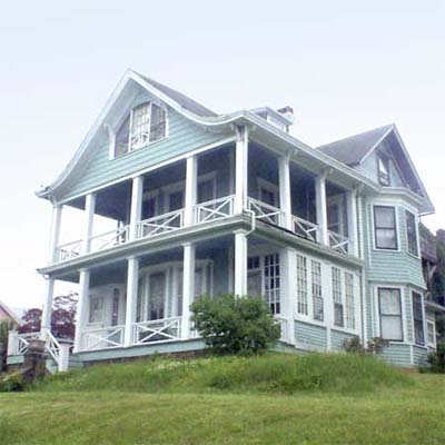 a Queen Anne with a double-tiered porch in the Atlantic Highlands, New Jersey