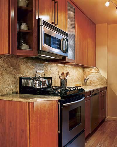 cherry kitchen cabinets, mocha granite, and red oak floors