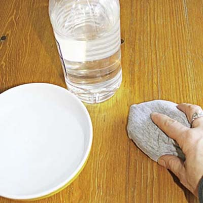 wiping wax build-up off wood using vinegar